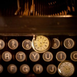 photo of antique keyboard and watch