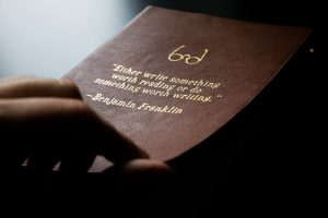 photo of Benjamin Franklin quote embossed on leather book cover