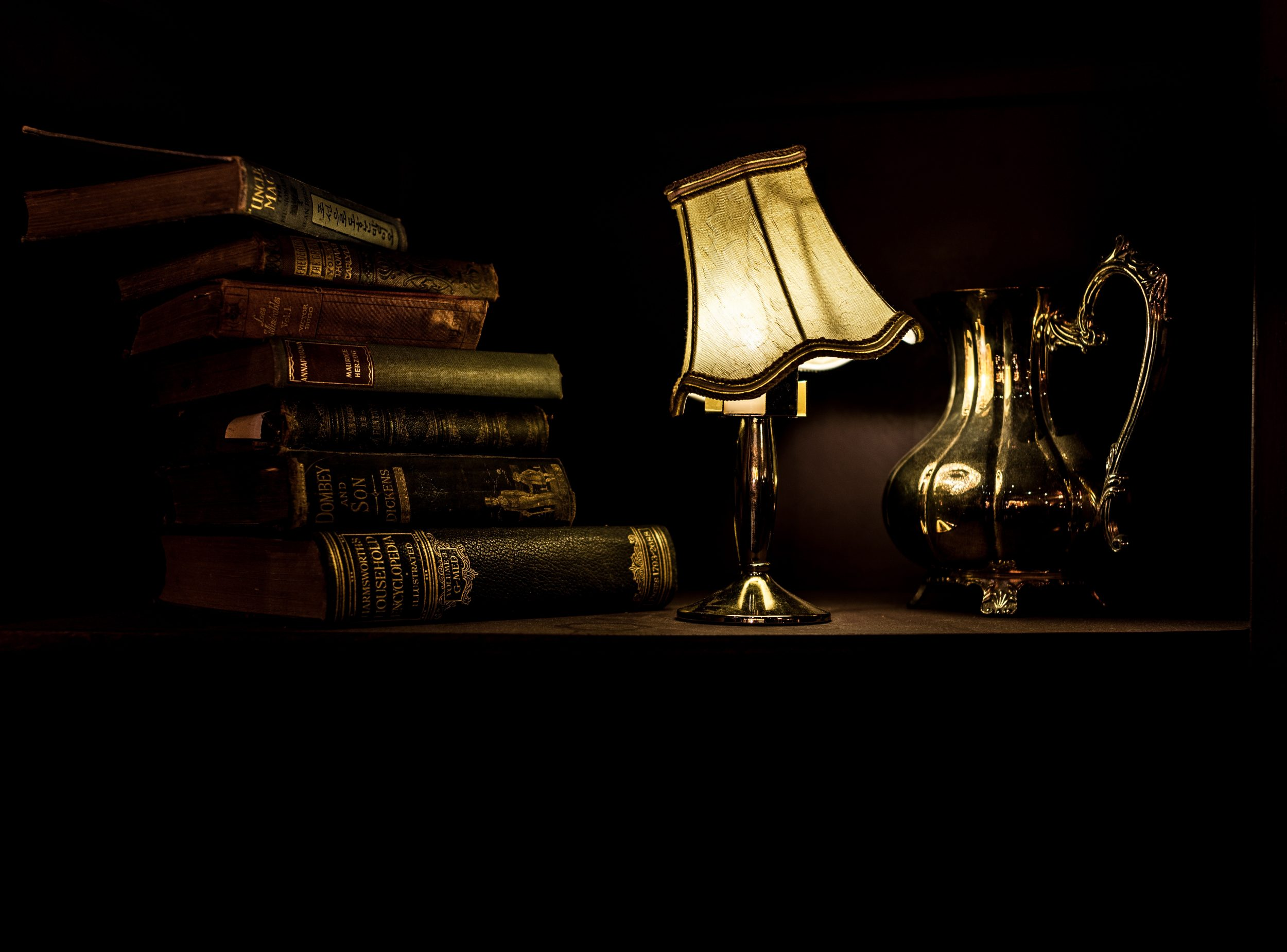 image of antique lamp and pile of books