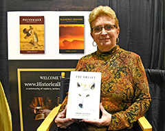 "photo of Marnie Sluman Somers holding newly lauched book, ""The Amulet"""