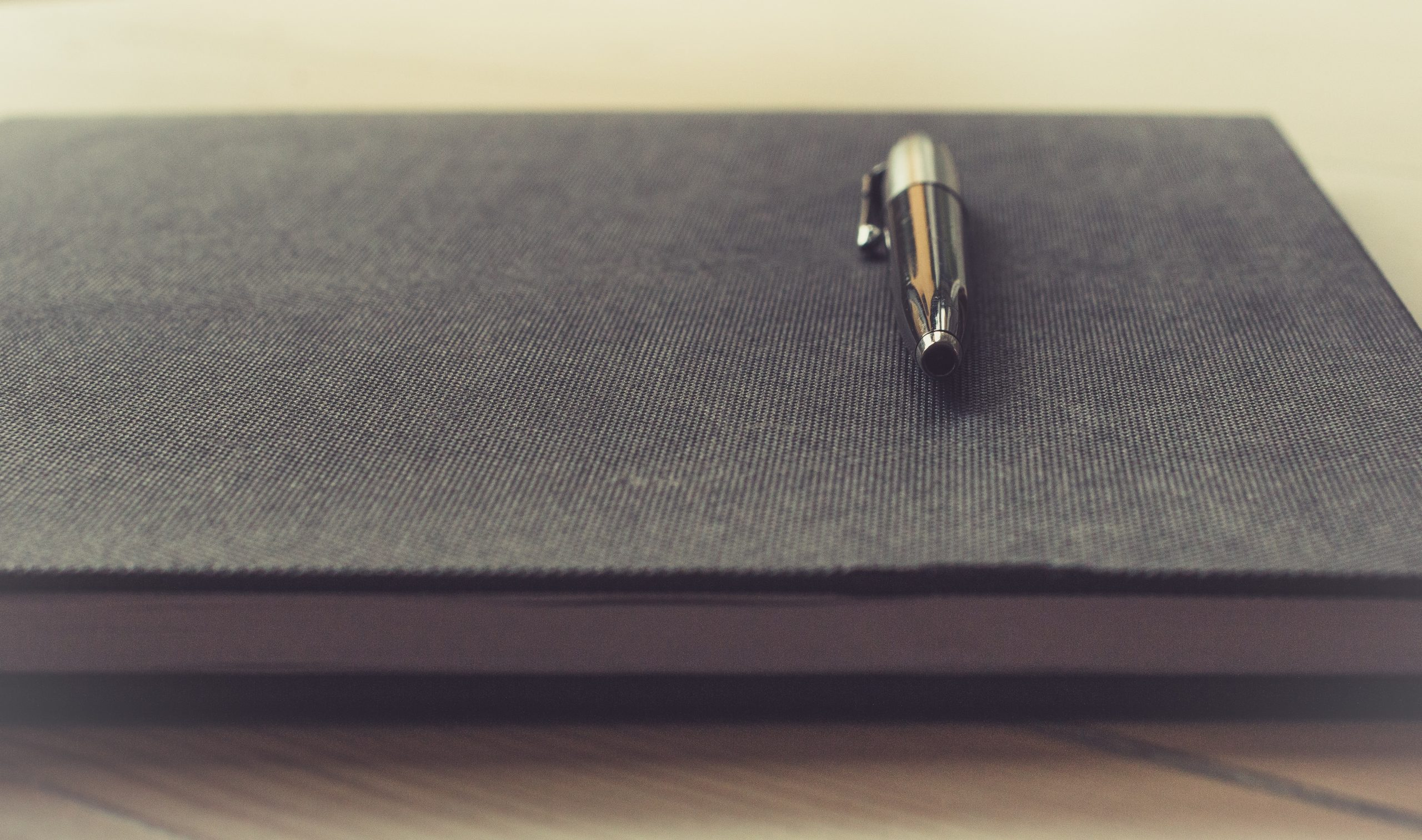 image of a writer's journal and fountain pen