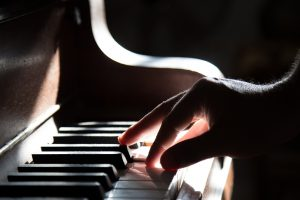 image of someone playing a piano