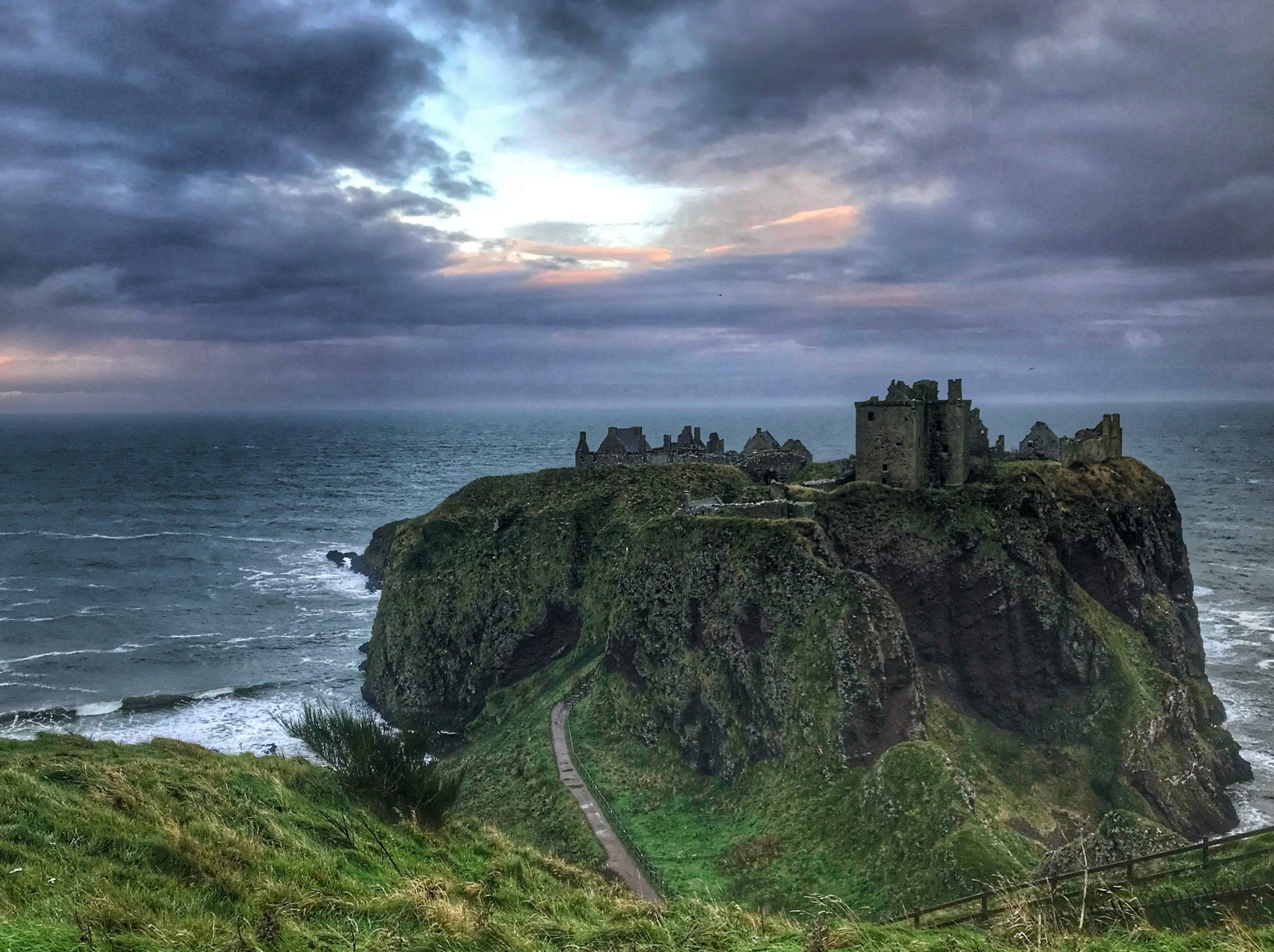 image of a ruined castle on an island with a sunset, how to use setting in your writing